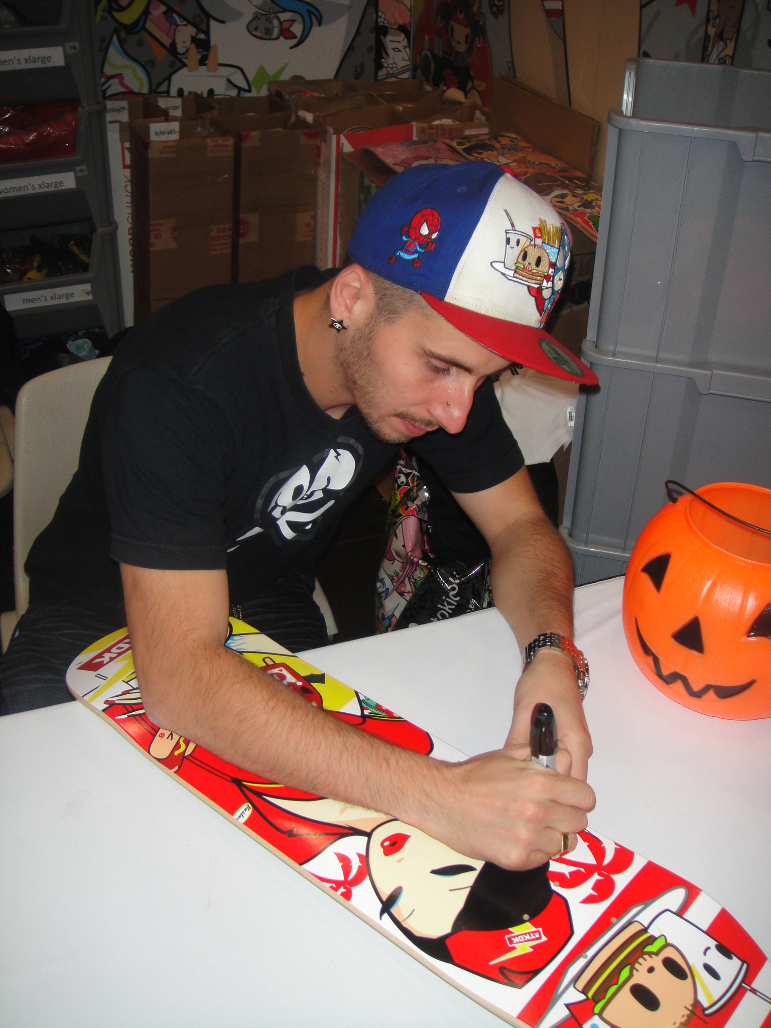 Went to Comic Con to get Simone Legno to sign skate deck...