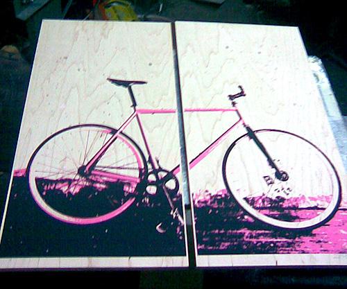 pink bike print on wood panels